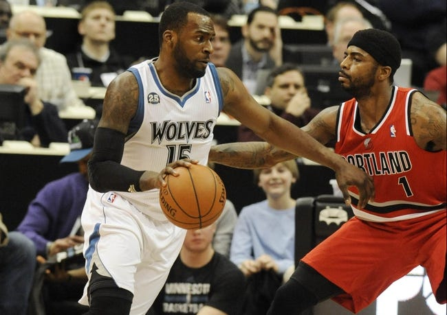 Feb 8, 2014; Minneapolis, MN, USA; Minnesota Timberwolves forward Shabazz Muhammad (15) moves to the basket around Portland Trail Blazers forward Dorell Wright (1) in the second quarter at Target Center.  The Trail Blazers defeated the Wolves  117-110.  Mandatory Credit: Marilyn Indahl-USA TODAY Sports
