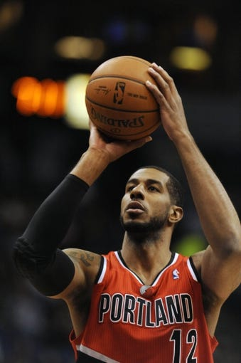 Feb 8, 2014; Minneapolis, MN, USA; Portland Trail Blazers forward LaMarcus Aldridge (12) takes a free throw first half against the Minnesota Timberwolves at Target Center.  The Trail Blazers defeated the Wolves  117-110.  Mandatory Credit: Marilyn Indahl-USA TODAY Sports