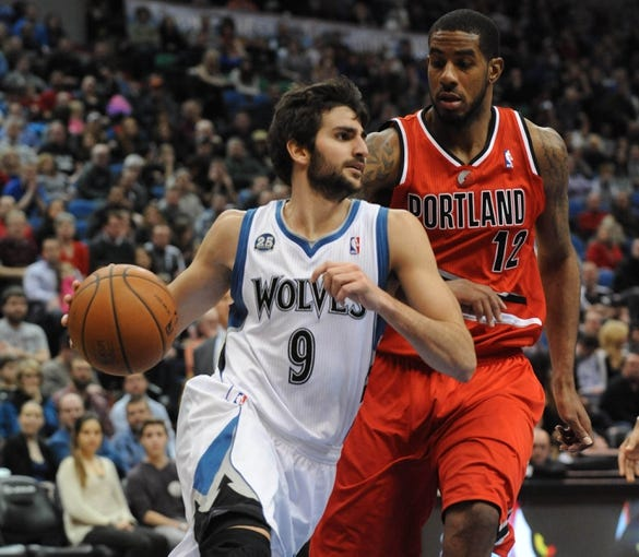 Feb 8, 2014; Minneapolis, MN, USA; Minnesota Timberwolves guard Ricky Rubio (9) drives to the basket guarded by Portland Trail Blazers forward LaMarcus Aldridge (12) in the second half at Target Center.  The Trail Blazers defeated the Wolves  117-110.  Mandatory Credit: Marilyn Indahl-USA TODAY Sports
