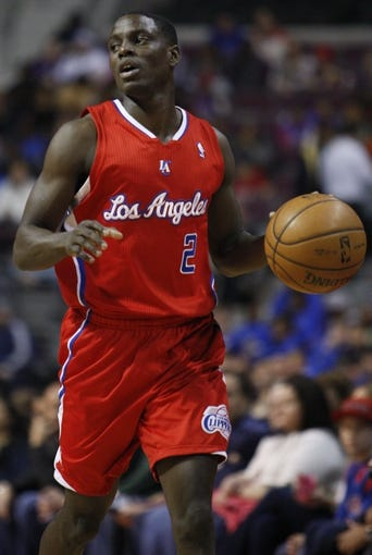 Jan 20, 2014; Auburn Hills, MI, USA; Los Angeles Clippers point guard Darren Collison (2) dribbles the ball up the court during the first quarter against the Detroit Pistons at The Palace of Auburn Hills. Clippers beat the Pistons 112-103. Mandatory Credit: Raj Mehta-USA TODAY Sports