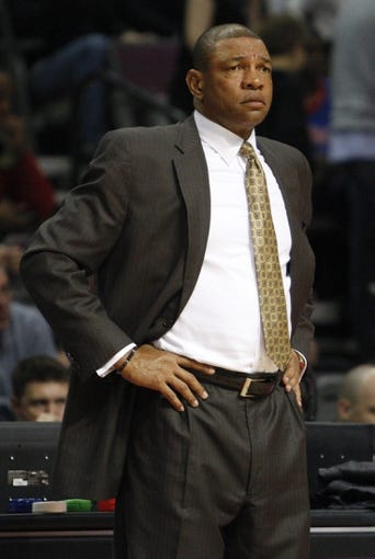 Jan 20, 2014; Auburn Hills, MI, USA; Los Angeles Clippers head coach Doc Rivers puts his hands on his hips during the third quarter against the Detroit Pistons at The Palace of Auburn Hills. Clippers beat the Pistons 112-103. Mandatory Credit: Raj Mehta-USA TODAY Sports