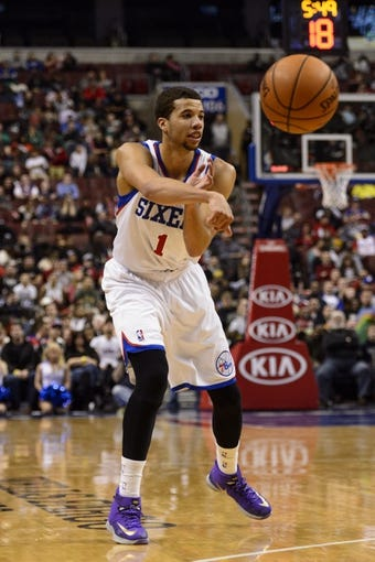 Feb 5, 2014; Philadelphia, PA, USA; Philadelphia 76ers guard Michael Carter-Williams (1) passes the ball during the fourth quarter against the Boston Celtics at the Wells Fargo Center. The Celtics defeated the Sixers 114-108. Mandatory Credit: Howard Smith-USA TODAY Sports