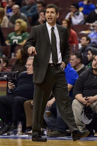 Feb 5, 2014; Philadelphia, PA, USA; Boston Celtics head coach Brad Stevens during the fourth quarter against the Philadelphia 76ers at the Wells Fargo Center. The Celtics defeated the Sixers 114-108. Mandatory Credit: Howard Smith-USA TODAY Sports