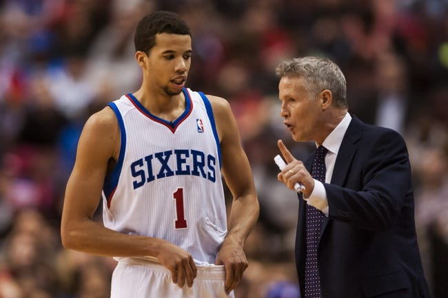 Feb 5, 2014; Philadelphia, PA, USA; Philadelphia 76ers head coach Brett Brown talks with guard Michael Carter-Williams (1) during the fourth quarter against the Boston Celtics at the Wells Fargo Center. The Celtics defeated the Sixers 114-108. Mandatory Credit: Howard Smith-USA TODAY Sports