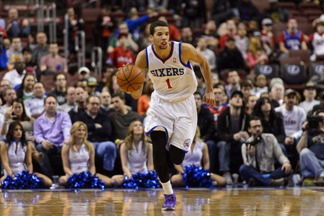 Feb 5, 2014; Philadelphia, PA, USA; Philadelphia 76ers guard Michael Carter-Williams (1) brings the ball up court during the fourth quarter against the Boston Celtics at the Wells Fargo Center. The Celtics defeated the Sixers 114-108. Mandatory Credit: Howard Smith-USA TODAY Sports