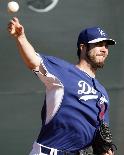 Feb 9, 2014; Glendale, AZ, USA; Los Angeles Dodgers pitcher Dan Haren (14) throws the ball during the first day of camp at Camelback Ranch. Mandatory Credit: Rick Scuteri-USA TODAY Sports