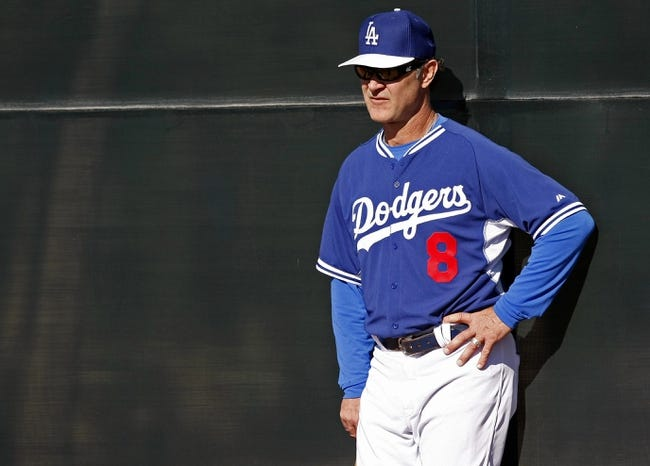 Feb 9, 2014; Glendale, AZ, USA; Los Angeles Dodgers manager Don Mattingly (8) looks on during the first day of camp at Camelback Ranch. Mandatory Credit: Rick Scuteri-USA TODAY Sports