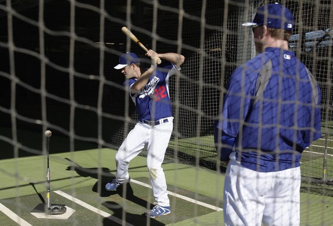 Feb 9, 2014; Glendale, AZ, USA; Los Angeles Dodgers starting pitcher Clayton Kershaw (22) takes batting practice during the first day of camp at Camelback Ranch. Mandatory Credit: Rick Scuteri-USA TODAY Sports