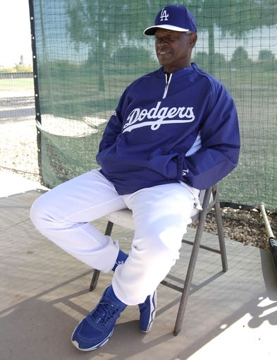 Feb 9, 2014; Glendale, AZ, USA; Los Angeles Dodgers coach Manny Mota during the first day of camp at Camelback Ranch. Mandatory Credit: Rick Scuteri-USA TODAY Sports