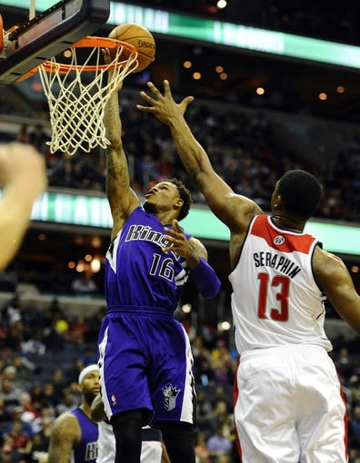 Feb 9, 2014; Washington, DC, USA; Sacramento Kings shooting guard Ben McLemore (16) shoots as Washington Wizards center Kevin Seraphin (13) defends during the second half at Verizon Center. The Wizards defeated the Kings 93 - 84. Mandatory Credit: Brad Mills-USA TODAY Sports