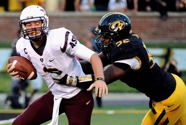September 15, 2012; Columbia, MO, USA; Arizona State Sun Devils quarterback Taylor Kelly (10) is brought down by Missouri Tigers defensive lineman Michael Sam (52) during the second quarter at Faurot Field. Mandatory Credit: Dak Dillon-USA TODAY Sports