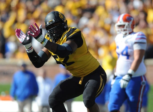 Oct 19, 2013; Columbia, MO, USA; Missouri Tigers defensive lineman Michael Sam (52) celebrates after sacking Florida Gators quarterback Tyler Murphy (3) (not pictured) during the first half at Faurot Field. Mandatory Credit: Denny Medley-USA TODAY Sports