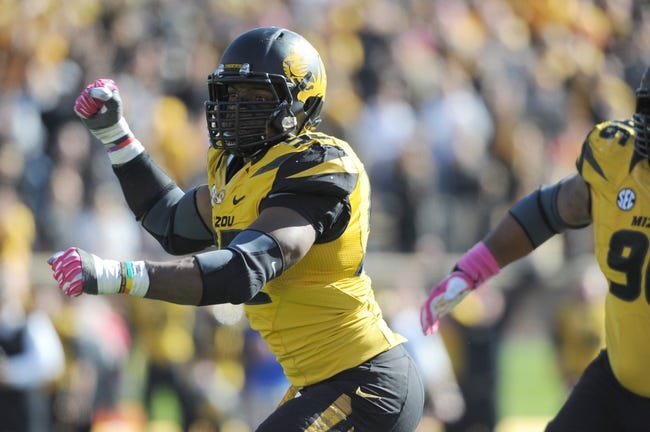 Oct 19, 2013; Columbia, MO, USA; Missouri Tigers defensive lineman Michael Sam (52) celebrates after sacking Florida Gators quarterback Tyler Murphy (3) (not pictured) during the second half at Faurot Field. Missouri won 36-17. Mandatory Credit: Denny Medley-USA TODAY Sports