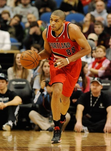 Feb 8, 2014; Minneapolis, MN, USA; Portland Trail Blazers forward Nicolas Batum (88) drives up court in the first half against the Minnesota Timberwolves at Target Center. The Trail Blazers defeated the Wolves  117-110.  Mandatory Credit: Marilyn Indahl-USA TODAY Sports