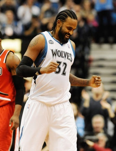 Feb 8, 2014; Minneapolis, MN, USA; Minnesota Timberwolves center Ronny Turiaf (32) celebrates a basket in the first half against the Portland Trail Blazers at Target Center. The Trail Blazers defeated the Wolves  117-110.  Mandatory Credit: Marilyn Indahl-USA TODAY Sports