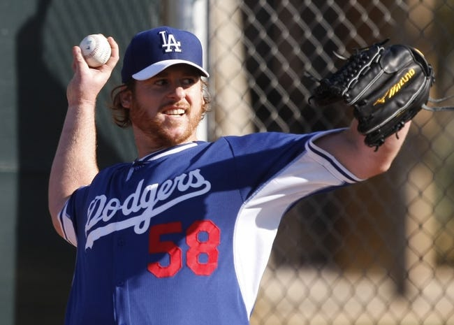 Feb 10, 2014; Glendale, AZ, USA; Los Angeles Dodgers starting pitcher Chad Billingsley (58) throws from the bullpen during camp at Camelback Ranch. Mandatory Credit: Rick Scuteri-USA TODAY Sports