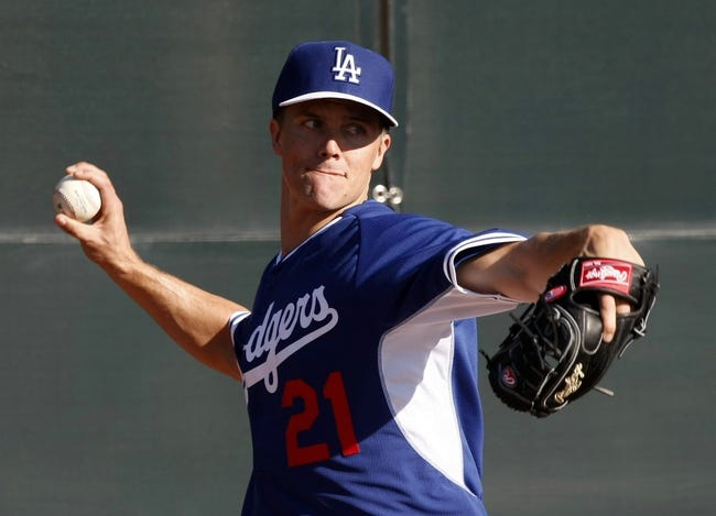 Feb 10, 2014; Glendale, AZ, USA; Los Angeles Dodgers starting pitcher Zack Greinke (21) throws from the bullpen during camp at Camelback Ranch. Mandatory Credit: Rick Scuteri-USA TODAY Sports