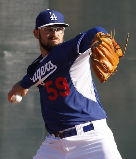 Feb 10, 2014; Glendale, AZ, USA; Los Angeles Dodgers starting pitcher Stephen Fife (59) throws from the bullpen during camp at Camelback Ranch. Mandatory Credit: Rick Scuteri-USA TODAY Sports