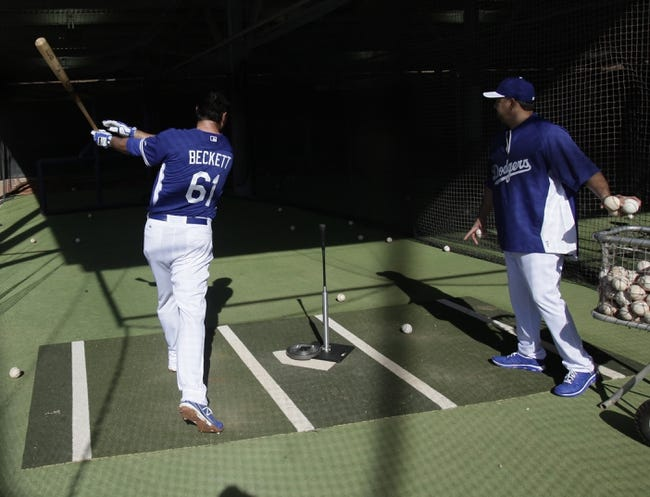 Feb 10, 2014; Glendale, AZ, USA; Los Angeles Dodgers starting pitcher Josh Beckett (61) hits in the cages during camp at Camelback Ranch. Mandatory Credit: Rick Scuteri-USA TODAY Sports