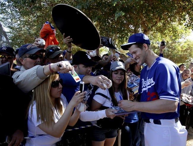 Feb 10, 2014; Glendale, AZ, USA; Los Angeles Dodgers starting pitcher Clayton Kershaw (22) signs autographs after camp at Camelback Ranch. Mandatory Credit: Rick Scuteri-USA TODAY Sports