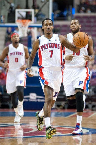 Feb 10, 2014; Auburn Hills, MI, USA; Detroit Pistons point guard Brandon Jennings (7) brings the ball up court against the San Antonio Spurs during the first quarter at The Palace of Auburn Hills. Mandatory Credit: Tim Fuller-USA TODAY Sports