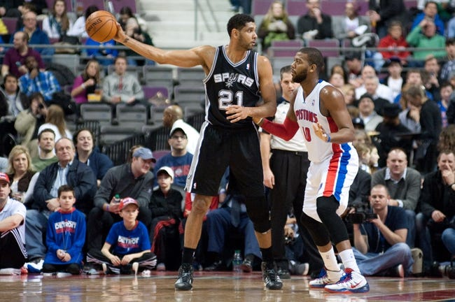 Feb 10, 2014; Auburn Hills, MI, USA; Detroit Pistons power forward Greg Monroe (10) guards San Antonio Spurs power forward Tim Duncan (21) during the first quarter at The Palace of Auburn Hills. Mandatory Credit: Tim Fuller-USA TODAY Sports