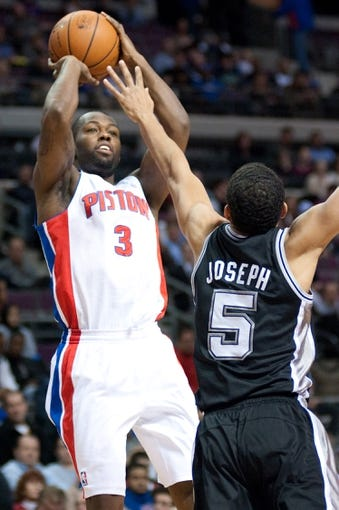 Feb 10, 2014; Auburn Hills, MI, USA; Detroit Pistons shooting guard Rodney Stuckey (3) shoots over San Antonio Spurs point guard Cory Joseph (5) during the first quarter at The Palace of Auburn Hills. Mandatory Credit: Tim Fuller-USA TODAY Sports