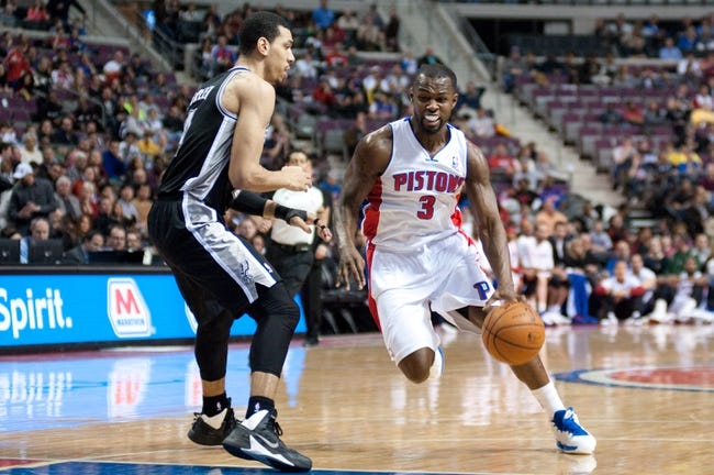 Feb 10, 2014; Auburn Hills, MI, USA; Detroit Pistons shooting guard Rodney Stuckey (3) drives to the basket against San Antonio Spurs shooting guard Danny Green (4) during the second quarter at The Palace of Auburn Hills. Mandatory Credit: Tim Fuller-USA TODAY Sports