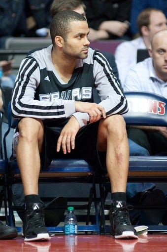 Feb 10, 2014; Auburn Hills, MI, USA; San Antonio Spurs point guard Tony Parker (9) watches from the bench during the fourth quarter against the Detroit Pistons at The Palace of Auburn Hills. Pistons won 109-100. Mandatory Credit: Tim Fuller-USA TODAY Sports