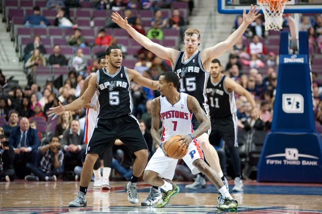 Feb 10, 2014; Auburn Hills, MI, USA; San Antonio Spurs point guard Cory Joseph (5) and power forward Matt Bonner (15) guard Detroit Pistons point guard Brandon Jennings (7) during the fourth quarter at The Palace of Auburn Hills. Pistons won 109-100. Mandatory Credit: Tim Fuller-USA TODAY Sports