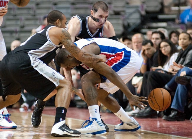 Feb 10, 2014; Auburn Hills, MI, USA; San Antonio Spurs point guard Shannon Brown (left) and point guard Nando de Colo (25) battle for a lose ball with Detroit Pistons shooting guard Rodney Stuckey (3) during the fourth quarter at The Palace of Auburn Hills. Pistons won 109-100. Mandatory Credit: Tim Fuller-USA TODAY Sports