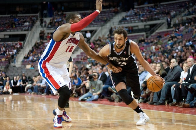 Feb 10, 2014; Auburn Hills, MI, USA; San Antonio Spurs point guard Cory Joseph (5) goes to the basket against Detroit Pistons power forward Greg Monroe (10) during the fourth quarter at The Palace of Auburn Hills. Pistons won 109-100. Mandatory Credit: Tim Fuller-USA TODAY Sports