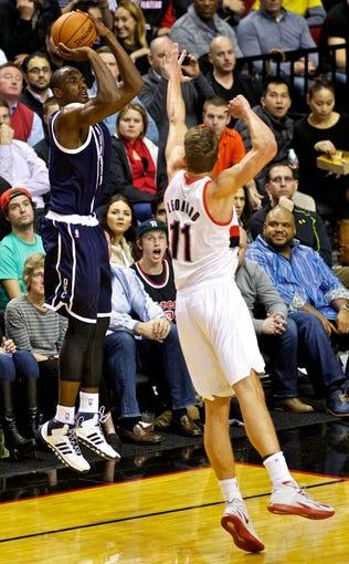 Feb 11, 2014; Portland, OR, USA; Oklahoma City Thunder power forward Serge Ibaka (9) shoots over Portland Trail Blazers center Meyers Leonard (11) during the third quarter at the Moda Center. Mandatory Credit: Craig Mitchelldyer-USA TODAY Sports