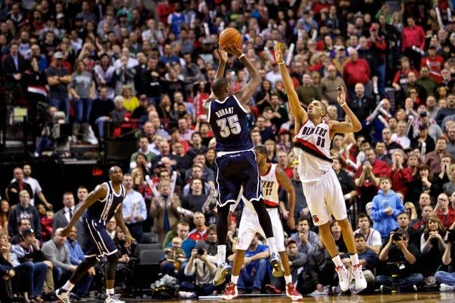 Feb 11, 2014; Portland, OR, USA; Oklahoma City Thunder small forward Kevin Durant (35) shoots over Portland Trail Blazers small forward Nicolas Batum (88) during the fourth quarter at the Moda Center. Mandatory Credit: Craig Mitchelldyer-USA TODAY Sports