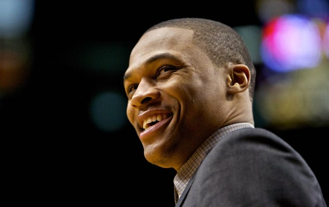 Feb 11, 2014; Portland, OR, USA; Oklahoma City Thunder point guard Russell Westbrook (0) smiles at the end of the game against the Portland Trail Blazers at the Moda Center. Mandatory Credit: Craig Mitchelldyer-USA TODAY Sports