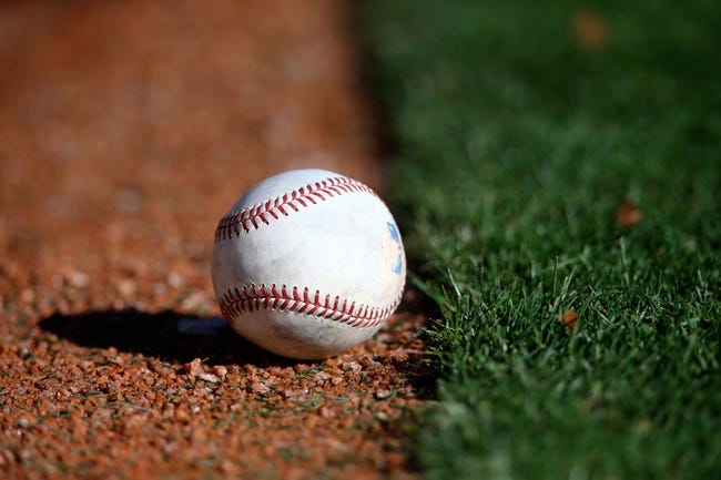 Feb 12, 2014; Glendale, AZ, USA; Detailed view of a baseball on the field during the Los Angeles Dodgers team workouts at Camelback Ranch. Mandatory Credit: Mark J. Rebilas-USA TODAY Sports