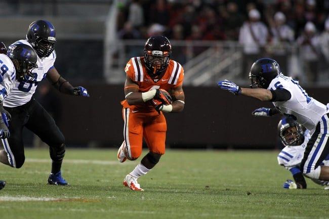 Oct 26, 2013; Blacksburg, VA, USA; Virginia Tech Hokies running back J.C. Coleman (4) runs with the ball against the Duke Blue Devils at Lane Stadium. Mandatory Credit: Peter Casey-USA TODAY Sports