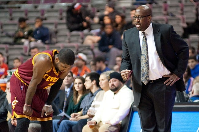 Feb 12, 2014; Auburn Hills, MI, USA; Cleveland Cavaliers head coach Mike Brown talks to point guard Kyrie Irving (2) during the first quarter against the Detroit Pistons at The Palace of Auburn Hills. Mandatory Credit: Tim Fuller-USA TODAY Sports