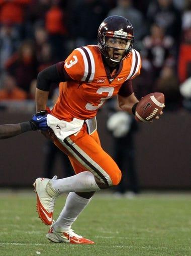 Oct 26, 2013; Blacksburg, VA, USA; Virginia Tech Hokies quarterback Logan Thomas (3) runs with the ball against the Duke Blue Devils at Lane Stadium. Mandatory Credit: Peter Casey-USA TODAY Sports