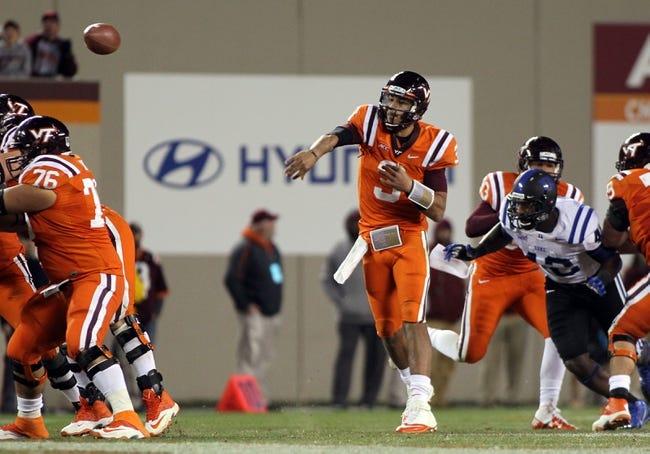 Oct 26, 2013; Blacksburg, VA, USA; Virginia Tech Hokies quarterback Logan Thomas (3) throws a pass during the game against the Duke Blue Devils at Lane Stadium. Mandatory Credit: Peter Casey-USA TODAY Sports