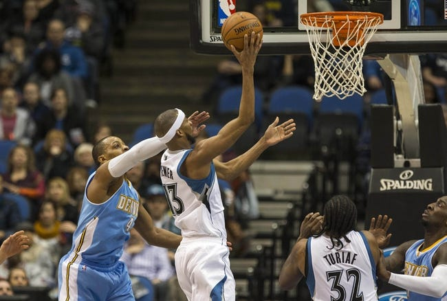 Feb 12, 2014; Minneapolis, MN, USA; Minnesota Timberwolves small forward Corey Brewer (13) goes up for a basket past Denver Nuggets shooting guard Randy Foye (4) in the first half at Target Center. Mandatory Credit: Jesse Johnson-USA TODAY Sports