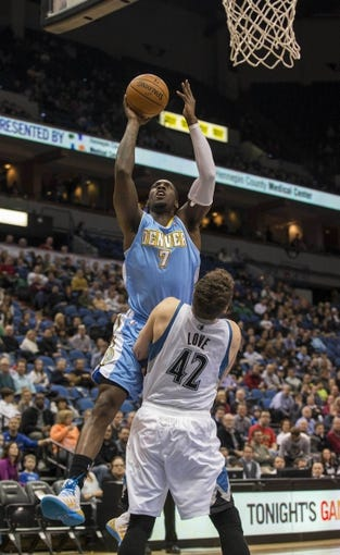 Feb 12, 2014; Minneapolis, MN, USA; Denver Nuggets center J.J. Hickson (7) goes up for a shot over Minnesota Timberwolves power forward Kevin Love (42) in the first half at Target Center. Mandatory Credit: Jesse Johnson-USA TODAY Sports