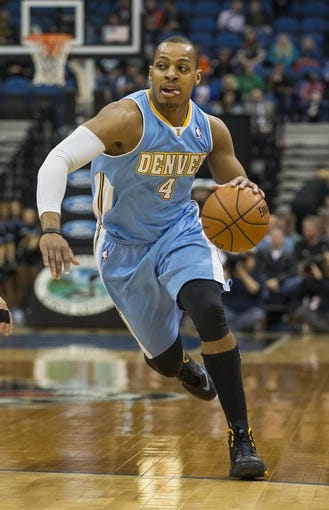 Feb 12, 2014; Minneapolis, MN, USA; Denver Nuggets shooting guard Randy Foye (4) moves to the basket in the first half against the Minnesota Timberwolves at Target Center. Mandatory Credit: Jesse Johnson-USA TODAY Sports