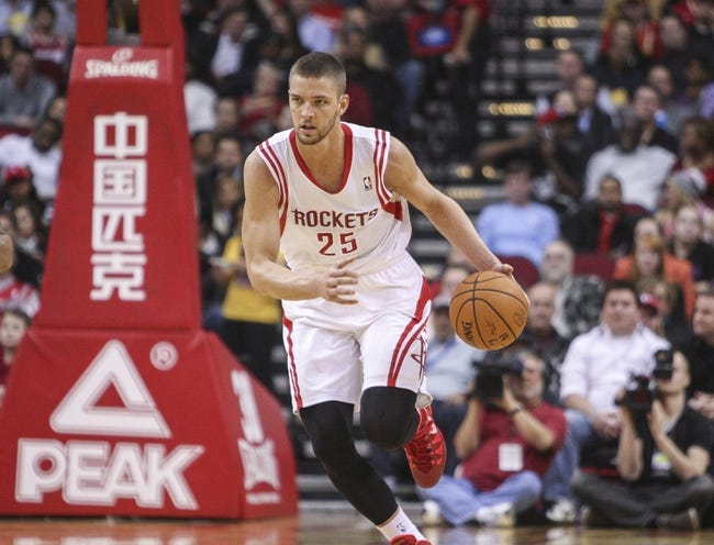 Feb 12, 2014; Houston, TX, USA; Houston Rockets small forward Chandler Parsons (25) brings the ball up the court during the second quarter against the Washington Wizards at Toyota Center. Mandatory Credit: Troy Taormina-USA TODAY Sports