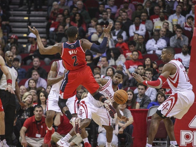 Feb 12, 2014; Houston, TX, USA; Washington Wizards point guard John Wall (2) loses control of the ball during the second quarter as Houston Rockets point guard Aaron Brooks (0) defends at Toyota Center. Mandatory Credit: Troy Taormina-USA TODAY Sports