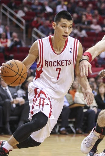 Feb 12, 2014; Houston, TX, USA; Houston Rockets point guard Jeremy Lin (7) drives the ball during the second quarter against the Washington Wizards at Toyota Center. Mandatory Credit: Troy Taormina-USA TODAY Sports