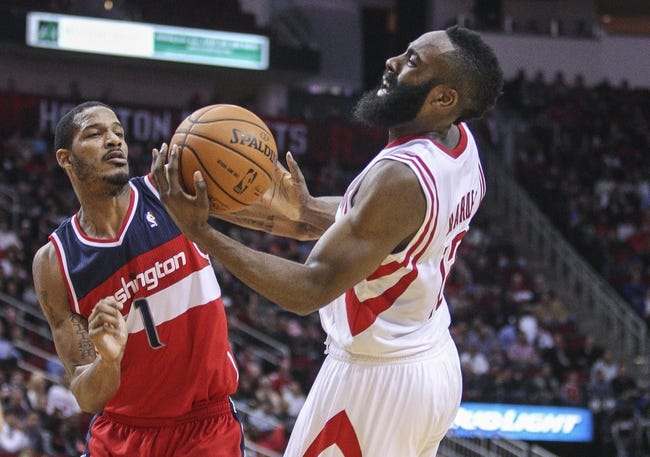 Feb 12, 2014; Houston, TX, USA; Washington Wizards small forward Trevor Ariza (1) and Houston Rockets shooting guard James Harden (13) battle for the ball during the second quarter at Toyota Center. Mandatory Credit: Troy Taormina-USA TODAY Sports