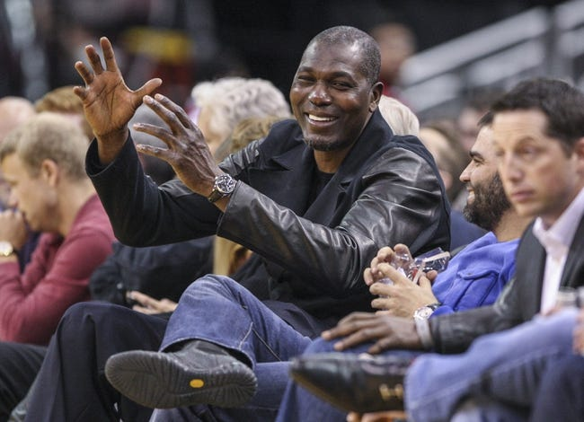 Feb 12, 2014; Houston, TX, USA; Former Houston Rockets basketball player Hakeem Olajuwon watches during the second quarter of a game against the Washington Wizards at Toyota Center. Mandatory Credit: Troy Taormina-USA TODAY Sports