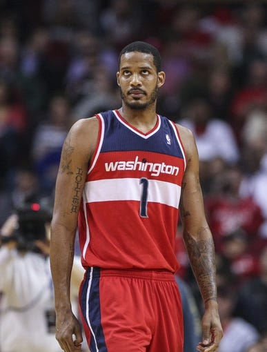 Feb 12, 2014; Houston, TX, USA; Washington Wizards small forward Trevor Ariza (1) reacts after a play during the second quarter against the Houston Rockets at Toyota Center. Mandatory Credit: Troy Taormina-USA TODAY Sports