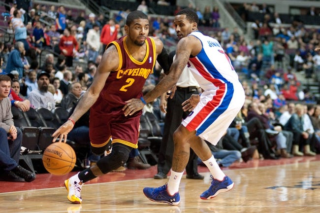 Feb 12, 2014; Auburn Hills, MI, USA; Cleveland Cavaliers point guard Kyrie Irving (2) goes to the basket against Detroit Pistons point guard Brandon Jennings (7) during the third quarter at The Palace of Auburn Hills. Cleveland won 93-89. Mandatory Credit: Tim Fuller-USA TODAY Sports